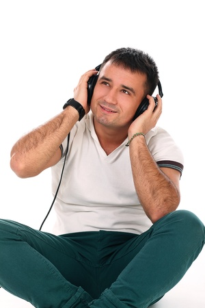 Young handsome man with headphones isolated over white background photo