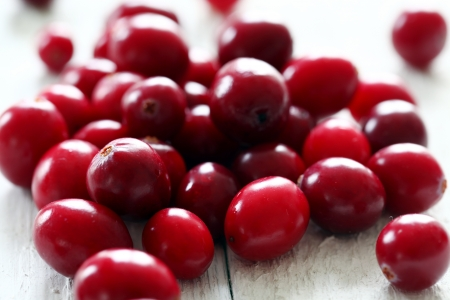 Fresh cranberries on a white wooden surface Stock Photo - 17721366