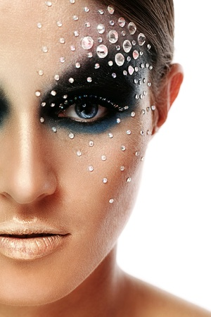 Closeup portrait of woman with artistic make-up isolated over white background photo