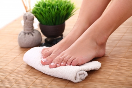 Image of SPA pedicure on bamboo surface photo