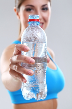 Water in a fitness bottle in woman hand Stock Photo - 17975303