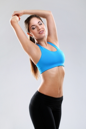 Young woman enjoying fitness isolated over background Stock Photo - 17975295