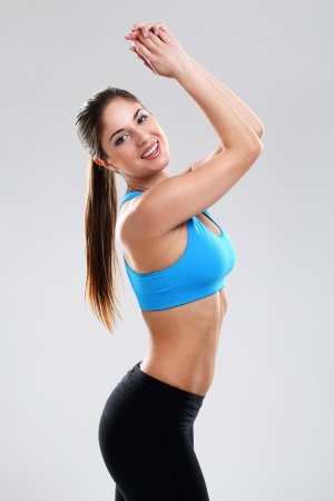 Young woman enjoying fitness isolated over background photo