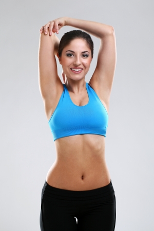 Young woman enjoying fitness isolated over background Stock Photo - 17975347