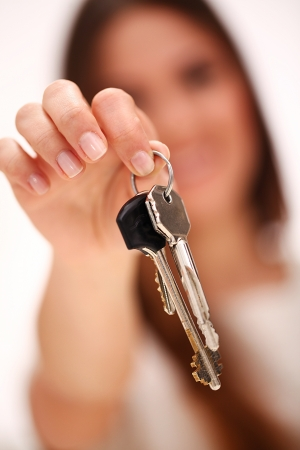 Beautiful caucasian woman holds keys photo