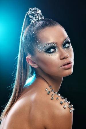 futuristic woman: Portrait of woman with artistic make-up and rhinestones over background