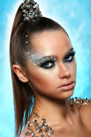 silver hair: Portrait of woman with artistic make-up and rhinestones over background