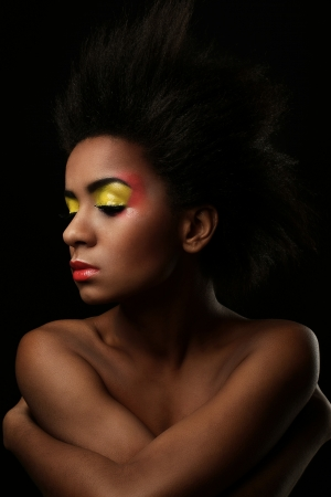 Beautiful black woman with glossy makeup isolated over black background Stock Photo - 18137471