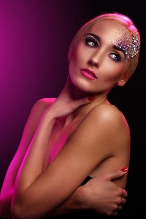 Beautiful woman with artistic makeup Stock Photo - 18314567