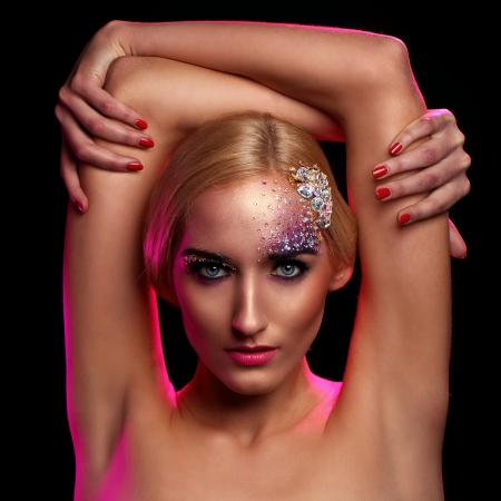 Beautiful woman with artistic makeup photo