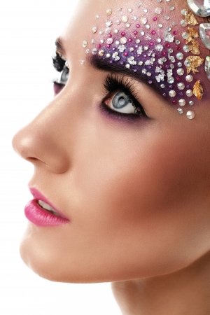 rhinestone: Beautiful woman with artistic makeup isolated over white background Stock Photo