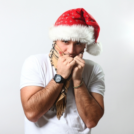 Handsome guy in christmas hat feels cold photo