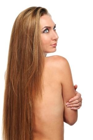 Caucasian woman with long beautiful blond hair isolated over white background photo