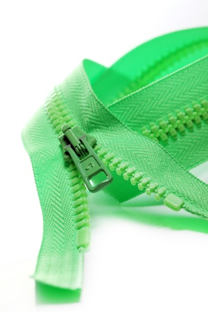 unbuttoned: A close up shot of a green zipper isolated over white backgrounds