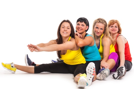 Group of women exercising over white background photo