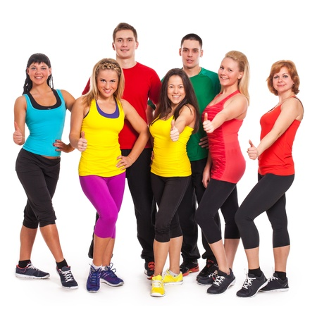 Fitness team in fitness wear standing over white background Stock Photo - 18609693