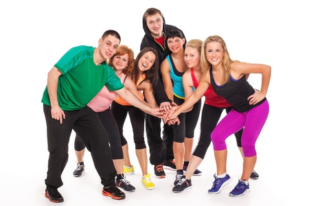Fitness team in fitness wear standing over white background Stock Photo - 18609520