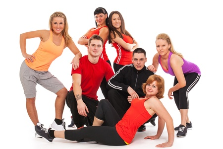 Fitness team in fitness wear standing over white background Stock Photo - 18610246
