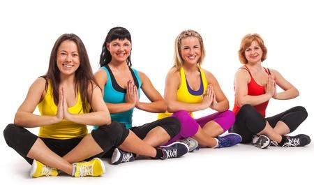 Group of women enjoying yoga over white background Stock Photo - 18609262