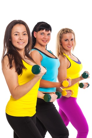 Beautiful happy women in fitness wear with dumbbells on a white background photo