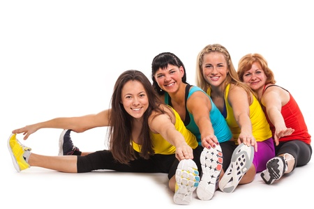 Group of women exercising over white background photo