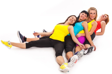 Group of women relaxes after exercises isolated over white background photo