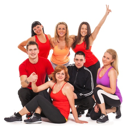 Fitness team in fitness wear standing over white background photo