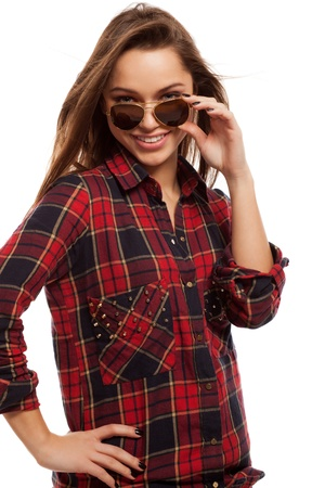 Young attractive woman in squared shirt and sunglasses photo
