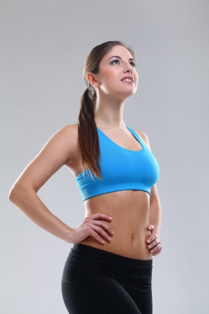 Beautiful caucasian woman in fitness wear over background Stock Photo - 19165107