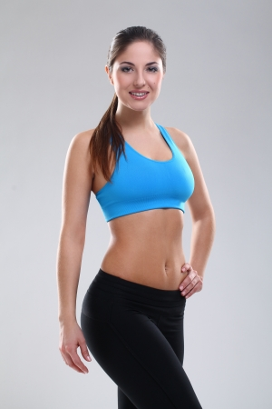 Beautiful caucasian woman in fitness wear over background Stock Photo - 19165082