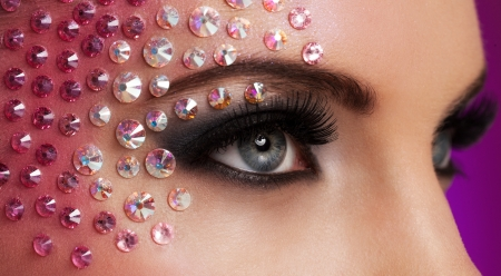 Closeup image of eyes with fantasy diamond makeup photo