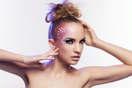 Beautiful woman with fantasy makeup on a white background photo