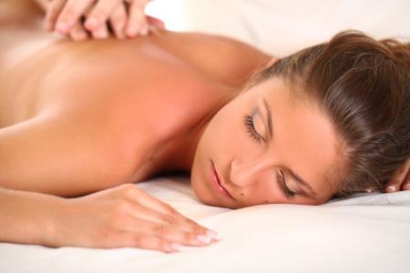 Portrait of beautiful caucasian woman enjoy massage photo