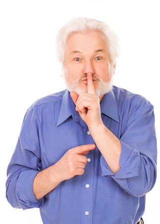 finger on lips: Handsome elderly man with gray beard asks be quiet isolated over white background Stock Photo