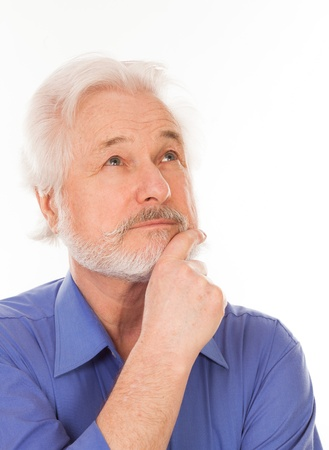 Handsome elderly man with gray beard thoughtful isolated over white background photo