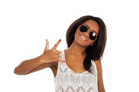 A portrait of a beautiful dark-skinned woman who is wearing sunglasses and showing sign with her hand photo