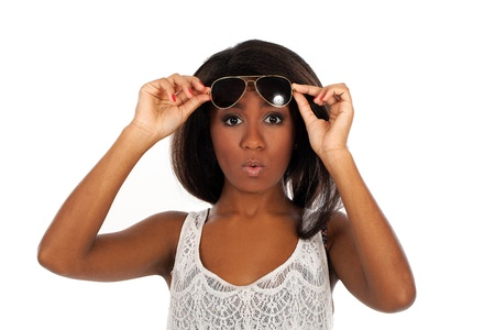 A portrait of a beautiful, surprised dark-skinned woman who is wearing sunglasses photo