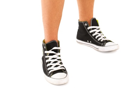 Picture of black sneakers with white laces on a white background photo