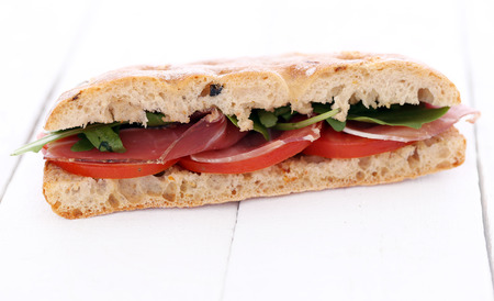 Closeup picture of a delicious sandwich over a white background photo