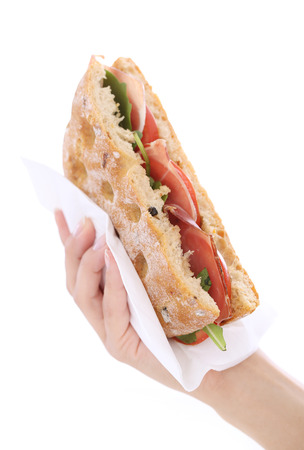 Picture of a tasty sandwich that is held by a hand photo