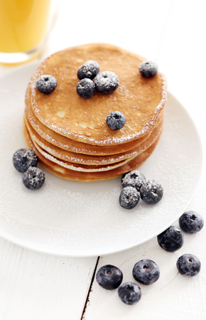 Picture of few pancakes with blackberries and sugar photo