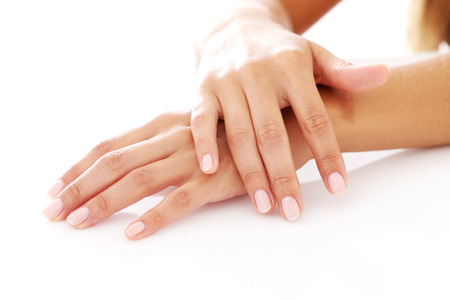 body grooming: Closeup of woman hands with manicure over a white background Stock Photo