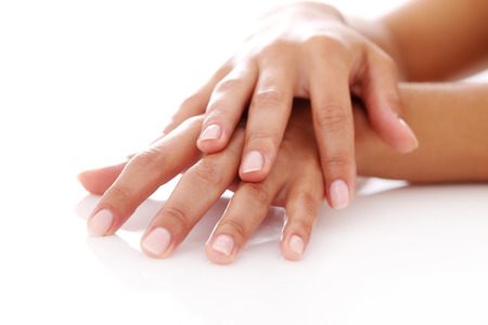 Closeup of woman hands with manicure over a white background photo