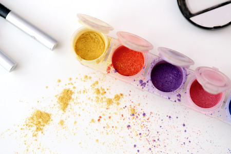 Picture of different-colored cosmetic powders with other cosmetic accessories Stock Photo - 23006569