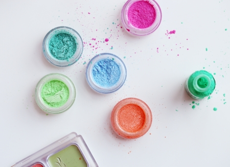 Picture of different-colored cosmetic powders with other cosmetic accessories Stock Photo - 23006571