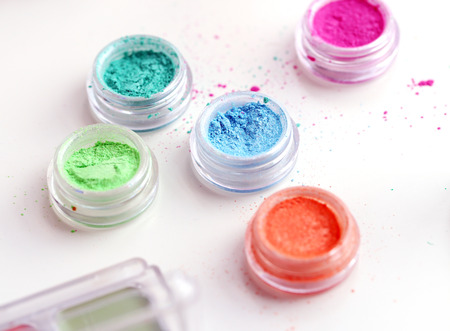 Picture of different-colored cosmetic powders with other cosmetic accessories Stock Photo - 23006572