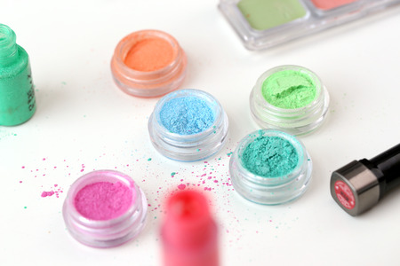 Picture of different-colored cosmetic powders with other cosmetic accessories Stock Photo - 23006633
