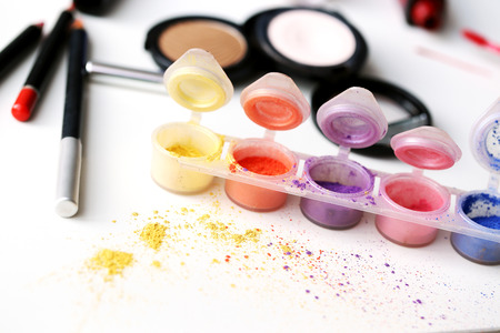Picture of different-colored cosmetic powders with other cosmetic accessories Stock Photo - 23006637