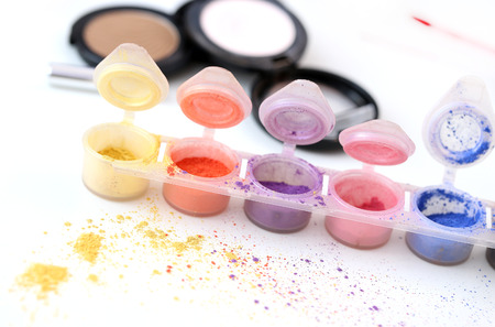 Picture of different-colored cosmetic powders with other cosmetic accessories Stock Photo - 23006639