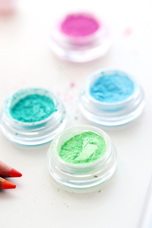 Picture of different-colored cosmetic powders with other cosmetic accessories Stock Photo - 23006675
